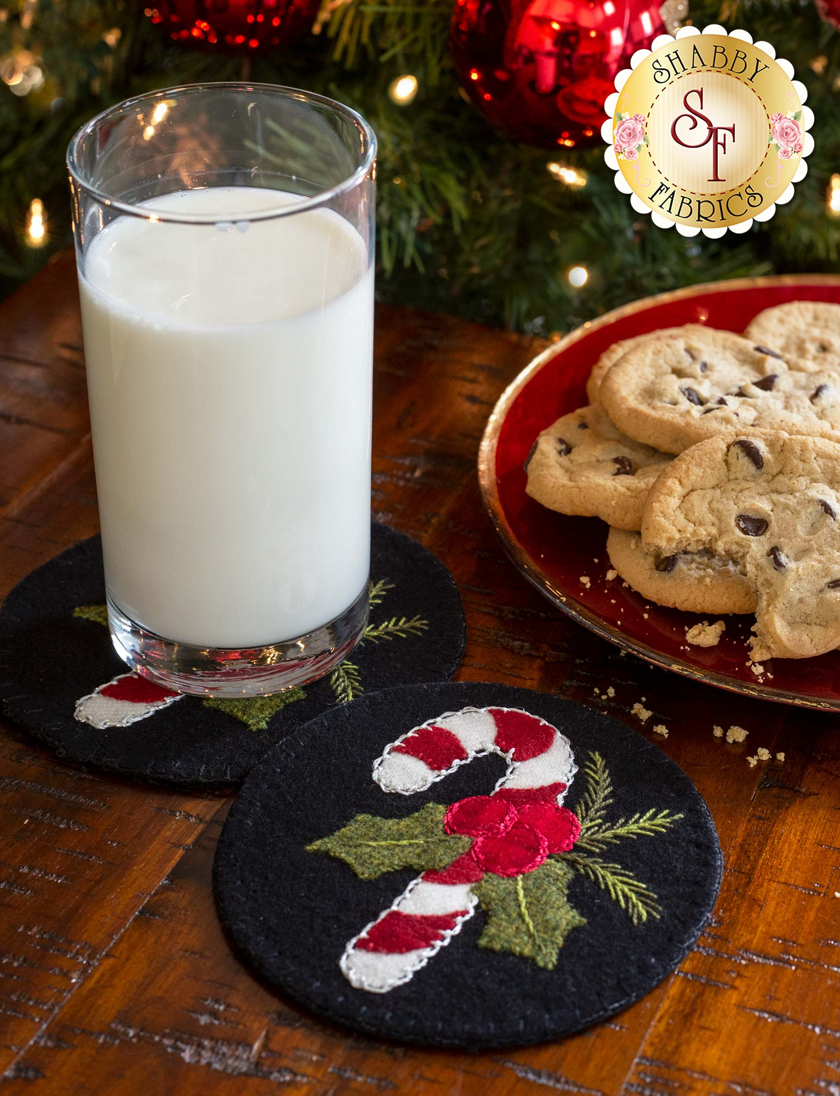 Candy Cane Wool Coaster with a plate of cookies and a glass of milk by a Christmas tree.