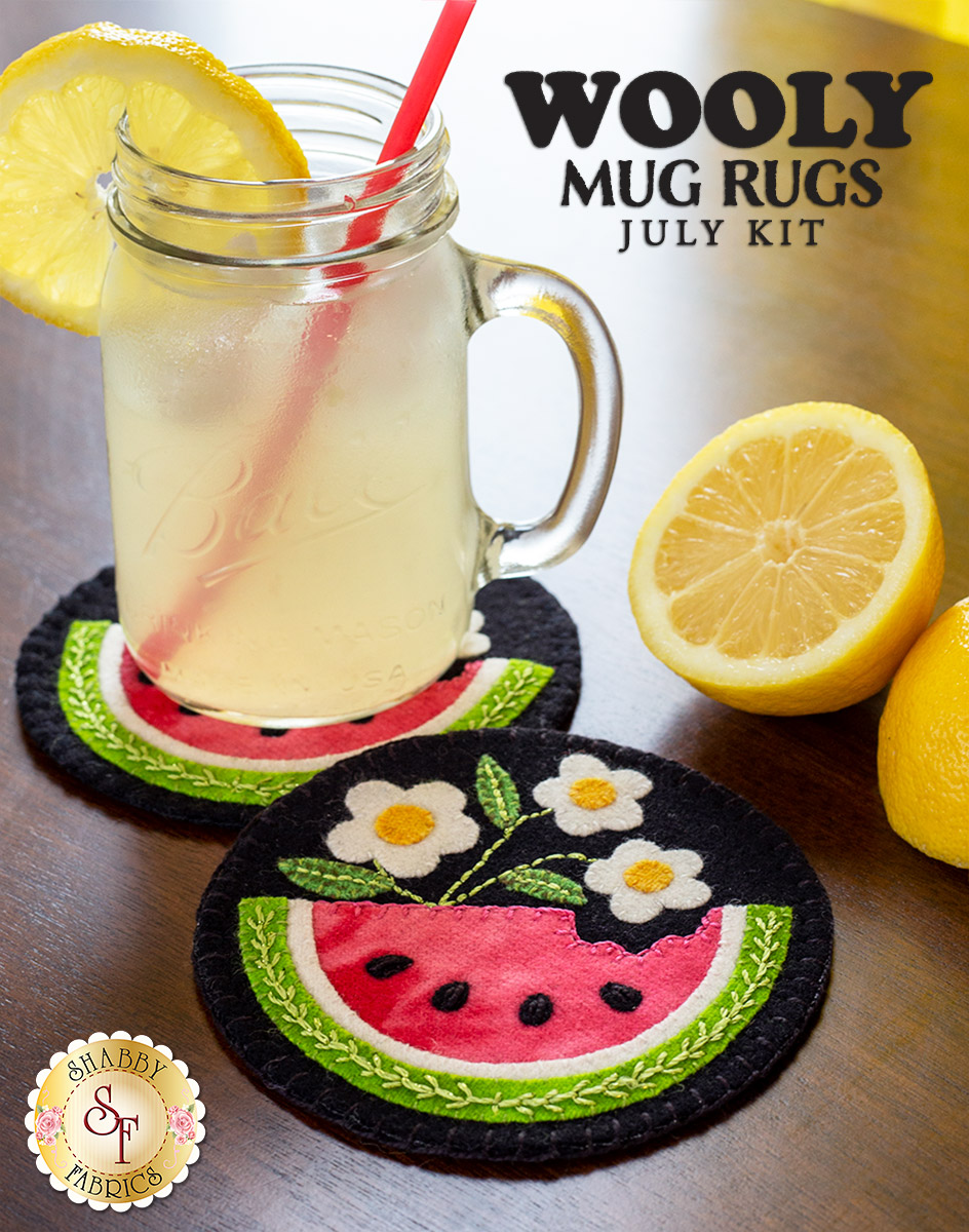 Wool coasters with watermelon appliqué on a wood table. Glass of lemonade and slice lemons in the photo.